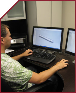 Employee using CAD/CAM system